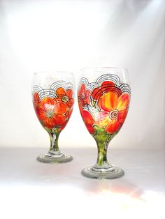 A perfect gift for a wedding, Christmas, anniversary, you name it! Hand Painted Glasses, Painted Goblets Serving Set Art on Glassware. $45.00, via Etsy.
