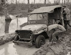 Crew of a jeep attempt to dig out their vehicle, bogged down in muddy conditions near Anzio, Italy. Description from net-maquettes.com. I searched for this on bing.com/images