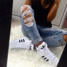 distressed denim + high-top adidas