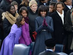 Michelle Obama, withSasha(L), Malia(C), wears a Thom Browne coat and colorful glovesfor President Barack Obama's 57th Presidential Inauguration ceremonial swearing-in at the US Capitol on January 21, 2013 in Washington, DC. Photo: STAN HONDA, AFP/Getty Images / AFP