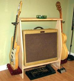 AIDAN - Get it off the ground a little and use the underneath for storage (Pedal board / microkorg) Mais. DIY Make Wooden multiple guitar rack . Guitar Hanger, Guitar Rack, Guitar Diy, Music Guitar, Cool Guitar, Guitar Storage, Guitar Display, Guitar Amp Stand, Wooden Guitar Stand