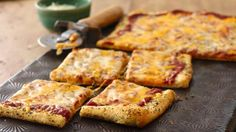 Pizza crust seasoned with herbs and butter makes a delicious base for a cheese pizza.