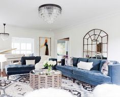 A tufted crushed velvet couch looks even more luxurious in a rich jewel tone. | Photographer: Amy Bartlam Photography | Designer: Homepolish