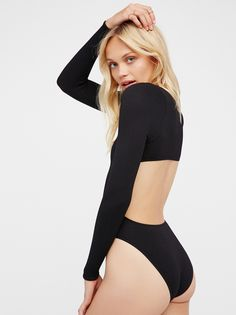 Viola Open Back Bodysuit | American made long sleeve bodysuit featuring a V-neckline and an open back cutout detail. Super stretchy fabrication. Perfect for layering.
