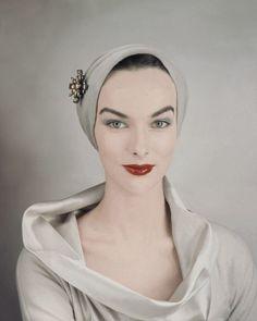 Ladylike elegance in beige silk. Flawless.    Photograph by Erwin Blumenfeld, 1954.