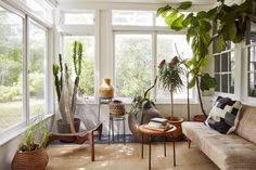 a light-filled sun room with vintage furnishings | modern shaker house tour designed by cs valentin on coco kelley