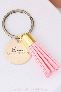 Custom engraved with your graduates name and graduation year. This personalized name keychain makes the cutest gift to any graduate. Shop more grad designs and color options at www.alistgreek.com! #grad #gradgifts #sororitygrad #collegegraduation #graduationgifts #graduation #gifts #keychain #tassel #custom #personalized #greekletter #aphi #kkg #kappa #tridelta #deltagamma