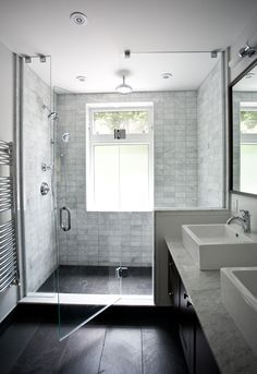 Marble shower tiles with black floor tile @Sarah Pierce - bingo