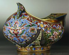 Largeantique gilded silver and shaded cloisonne enamel kovsh by one of the best Russian enamelers - Maria Semyenova,of traditional boat shape with hook handle. The exterior of the bowl is completely covered with elaborate floral designs on richly colored grounds. Made in Moscow between 1908 and 1917.