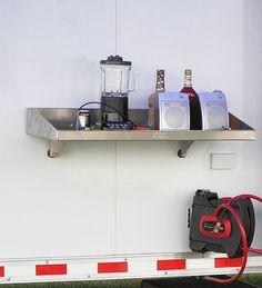 """Clip-on Trailer Tray - This clip-on tray with easy on and off design provides ample table space for portable outside pit use. Large enough for all pit needs, yet stores easily inside trailer. Protective bumpers, support brackets and key punch brackets included.   Dimensions: 38""""W x 5 1/2""""H x 17""""D http://www.pitpal.com/trays-caddies/clip-on-trailer-tray/"""