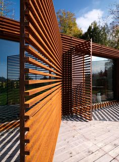 CASA Y- Turin by F:L architetti.  CorTen steel masquerading as wood screening.