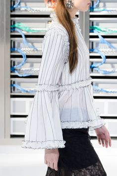 Chanel Spring Summer Collection is a throwback to the early 1990s with sideways baseball caps, oversized chains, hoodies and giant earrings.