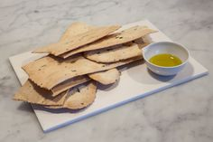 """Lingue Crackers Rosemary : """"Mother in Laws tongues"""" Crackers are a large Italian cracker which goes well with a selection of chees or just as a store cupboard snack. Classic Rosemary flavour. Made using the finest Olive oil these have long been a favourite for us. Due to the length and delicate nature of the crackers they rarely stay in one long length and are prone to snapping. This does not effect the flavour and they look great stacked in pile for people to share."""