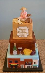 This birthday cake features all the birthday girl's favorite things- her kids, dogs, wine and cheese, and shopping!