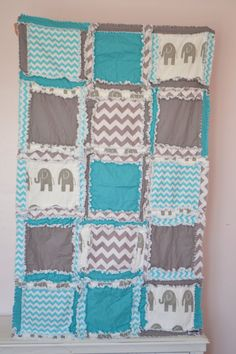 A crib size RAG QUILT in Elephant, Chevron, and Polka Dot patterns. The perfect Baby Blanket in Turquoise Blue and Gray is made to order. This