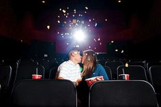 Engagement photos in a local theatre for these movie lovers! Photography by thegoodness.com
