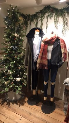 - Image 8 - 11/20/16 @ 3:10pm - Free People Flatiron - iPhone 6 Plus - Just when I thought that Free People's holiday decorating couldn't get any better, I walked downstairs. I love this display with the Christmas tree and the winter outfits. These mannequins give customers outfit ideas that can be worn all winter long. The placement of this display really works because it is right on the staircase where people are forced to look when walking down the stairs.