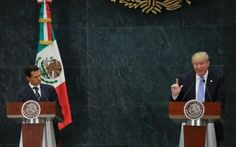 US Republican presidential nominee Donald Trump and Mexico's President Enrique…