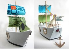 All aboard! This Cheerful Cardboard Pirate Ship is no match for milk carton ships of the past. Add any fabric you want to make colorful sails, or paint the hull for even more fun. Boys and girls alike will love this Cheerful Cardboard Pirate Ship. Cardboard Pirate Ship, Diy Cardboard, Diy For Kids, Crafts For Kids, Diy Karton, Bateau Pirate, Pirate Boats, Homemade Toys, Craft Activities For Kids