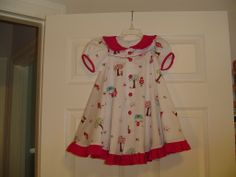 The pattern is Madeline by the Children's Corner (revised version).  Riley Blake fabic.  Size 3