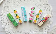 This set of 6 mini clips feature fun prints of pineapples, flamingos, watermelon, parrots, and ferns. These colorful clothespins can be used to clip tags and banners in place at your summer party, clip school work, or clip photos.  Each clip measures 1 3/4 x 1/2.  All of my items are made in my smoke free home. ----------------------------------------------------------------------- Want to see more of my shop? Click here! https://www.etsy.com/shop/TiddleywinksDes...
