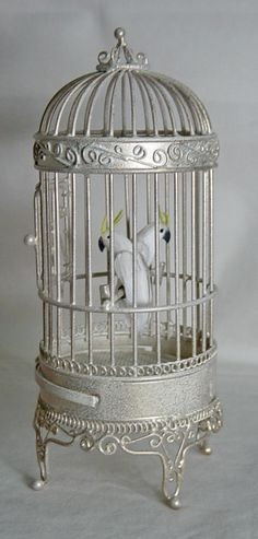 UNIQUE MINIATURES, VAL HARPER - Floor Standing Bird Cage and two Cockatoo's.This is a floor standing birdcage white cockatoo's with real feathers. I have called the birds SAMSON & DELILAH
