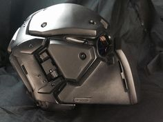 "This is the DevTac Japan ""Ronin"" helmet. Not just a show piece, this is a fully functional Kevlar level 3a bullet-proof helmet! The best part of it (for me) is that the helmet is in two halves; a backplate that's strapped to your head, and the front section fixes in place with strong magnets. I'm in the process of finding out how much these cost, but I suspect it'll be way out of my range."