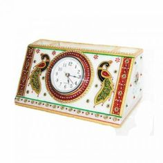 Make your office desk, children's desk and computer table look fantastic with this glamorous Marble Penstand with Clock . Crafted in pure white marble, it is embellished with Meenakari and kundan work that is complemented by expert enamelwork. Exquisitely designed and intricately crafted, it makes for a perfect gifting option.