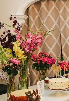 Tall vases decorated with cute tiny bunting and filled with wild-looking flowers decorated the desserts table.
