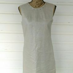 Cynthia Rowley Metallic Cream Linen Dress Beautiful light tan with silver sheen linen dress in excellent condition, no signs of use. Size 6, slightly large, could fit a size 8. Beautiful square stud neckline and down the back. Stunning modern take on a classic. Offers always warmly welcomed. Cynthia Rowley Dresses Midi