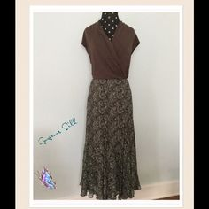 NWOT 🆕Jones New York skirt 🔥NWOT 🎀Beautiful 100% silk skirt is fully lined & has a flouncy hemline. Hidden Side zipper and hook closure. Colors of brown, Lt teal and cream swirl together in a beautiful, timeless design. This has Never been worn. (Bought when it was too small, but then I lost too much weight & now too large for me😩). Simply lovely! Jones New York Skirts