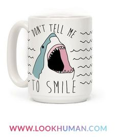 """Show off your love of sharks and your hatred of the patriarchy with this shark lover's, shark week inspired, """"Don't Tell Me To Smile"""" coffee mug! Now show off those razor sharp teeth and tell those jerks to f*** off!"""