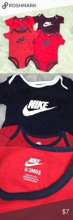 Baby Nike Onesies 4-pack never worn 0-3 months Never worn, 4 pack of Nike Onesies. 2 red, 1 navy blue and 1 burgundy with Nike swoosh on front.  Snaps on bottom. Size 0-3 months. Nike One Pieces