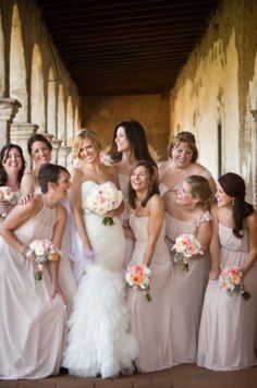 Love how the bridesmaids all have different, but complimentary dresses!