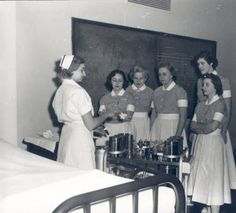 """Students of the Jewish Hospital School of Nursing receiving clinical instruction, 1950s. """"Bernard Becker Medical Library, Washington University in St. Louis"""""""