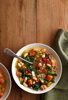 Kale Soup with Sweet Potatoes and Sausage Recipe—This soup is a little spicy, a lot meaty, and full of good-for-you greens.
