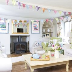 colourful living room. Maybe not bunting though. I love bunting, but I sew enough of it... Colourful Living Room, Beautiful Living Rooms, New Living Room, Living Room Modern, Living Room Designs, Living Room Decor, Colourful Lounge, Dining Room, Living Area