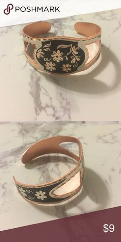 Rose gold colored bracelet Super cute rose gold bangle with black and silver accents, flowers. Never worn before and adjustable to fit anyone's wrist Jewelry Bracelets