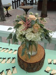 Hydrangea, eucalyptus with few peach roses for this rustic escort card table