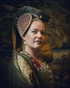 The hennin was a headdress in the shape of a cone, beehive or a heart, worn in the late Middle Ages by European women of the nobility. They were most common in Burgundy and France, but also at the English courts, Northern Europe, Hungary and Poland. The word hennin is recorded as being used in French in 1428