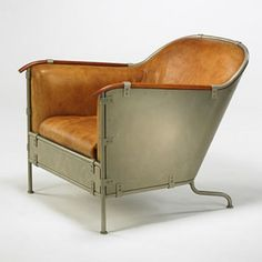 MATS THESELIUS    Rex armchair    Kallemo  Sweden, 1990  leather, enameled steel, cherry  28 w x 37 d x 29 h inches