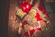 Gold jewellery matching the gold and red lehenga by Rathod Jewellers.  weddingz.in   India's Largest Wedding Company   Wedding Venues, Vendors and Inspiration   Indian Bridal Wedding Jewellery Fashion  