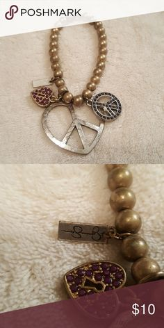 Peace & Love Bracelet Bronze beaded bracelet with peace and heart charms. Jessica Simpson Jewelry Bracelets