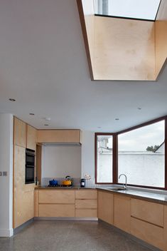 sunroof Tile-covered walls reflect light into Greenlea Road extension by GKMP Architects
