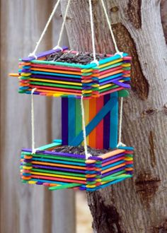 Popsicle Stick Bird House #1 Easy Birdhouse made out of colored craft sticks (Popsicle Sticks) , & yarn cost about $2 to make