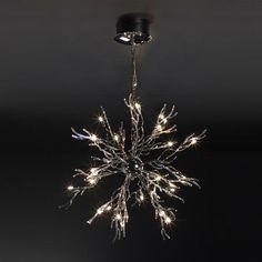 Lustre halogène 20 lumières Coralia. Ampoules de type Halogène 12V G4 10W incluse. Lustre composé de 24 ampoules, structure Métal et verre, finition Chrome.