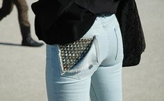 awesome ripped back pocket studded jeans...I'm sure this will be an easy DIY