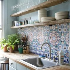 Maybe the plain wall to match the blue kitchen walls