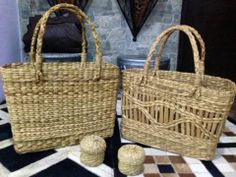 This years, Eco- friendly statement, carry your stuff, the indie way! We believe in taking our indian crafts ahead! Hand- woven, moss grass baskets with handles.  Sizes: plain basket: 39x29 cms  Price: Rs 800 Basket with pattern: 26x38 cms Price: Rs 900 For details of the products and to place an order, you can whatsapp on 9999968917, +34630292108 or email at veralikasingh@hotmail.com or maddy_rawat@hotmail.com.