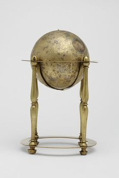 Celestial globe Place of origin: Lahore, Pakistan (made) Date: 1650 (made) 1800 - 1900 (made) Artist/Maker: Unknown (production) Diya al-Din Muhammad, born 1615 - died 1684 (made) Materials and Techniques: [celestial globe] Brass, cast, engraved, and inlaid with silver. Brass, with no seam but two visible plugs, one of a different alloy from the rest of the globe. Stars inlaid with silver points. Engraved with the equator, circles of latitude, and zodiac constellations.